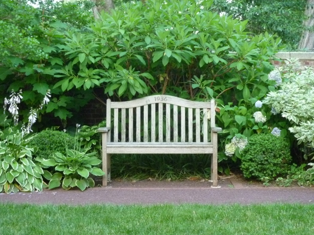 Teak bench at Princeton University's Maclean House garden, Princeton, NJ.