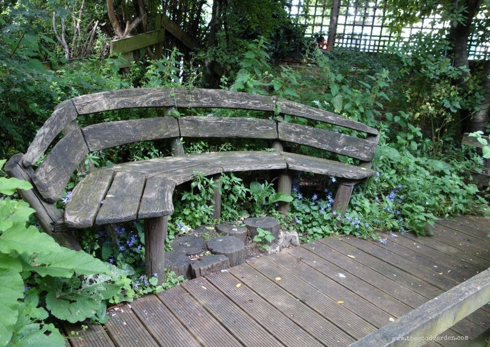 Neighborhood conversation bench, secret garden, London, UK.
