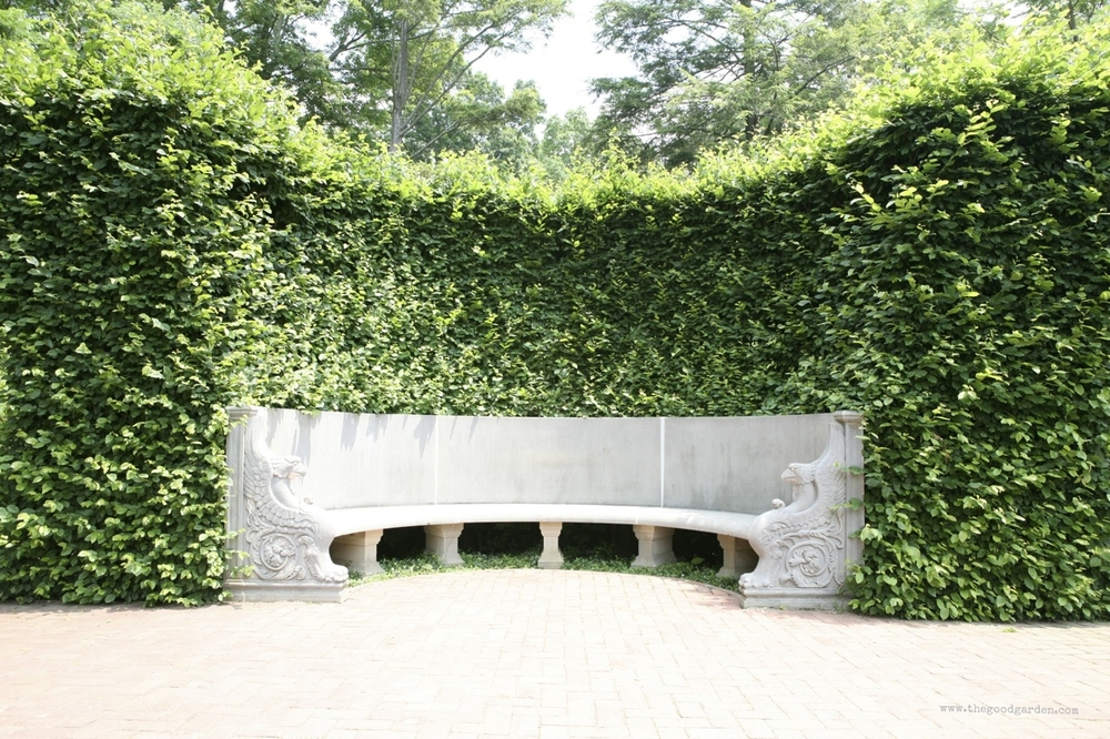 A semi-circular cut out creates a sheltered seating area at Longwood Gardens. Pennsylvania, US.