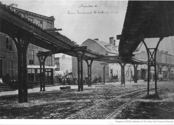 Photo from the 1870's of an elevated train that was one block from where the High Line was later built.  Source: The New York Historical Society.