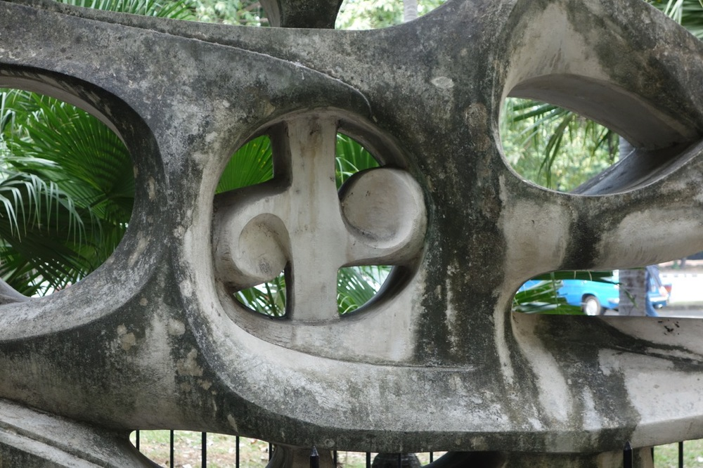 """Detail from """"Crisalida"""" (1959) by Alfredo Lozano is set in the middle of a quiet palm grove.  Crisalida means chrysalis in English."""