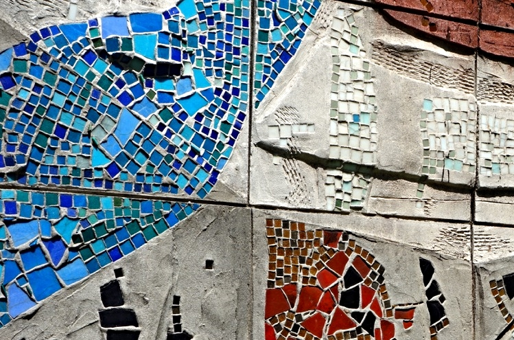 """Detail from """"Formas Geometricas"""" (1959) by Raul Martinez fills an entire wall with ceramic tile and concrete.  It defines the space that leads to the main auditorium."""