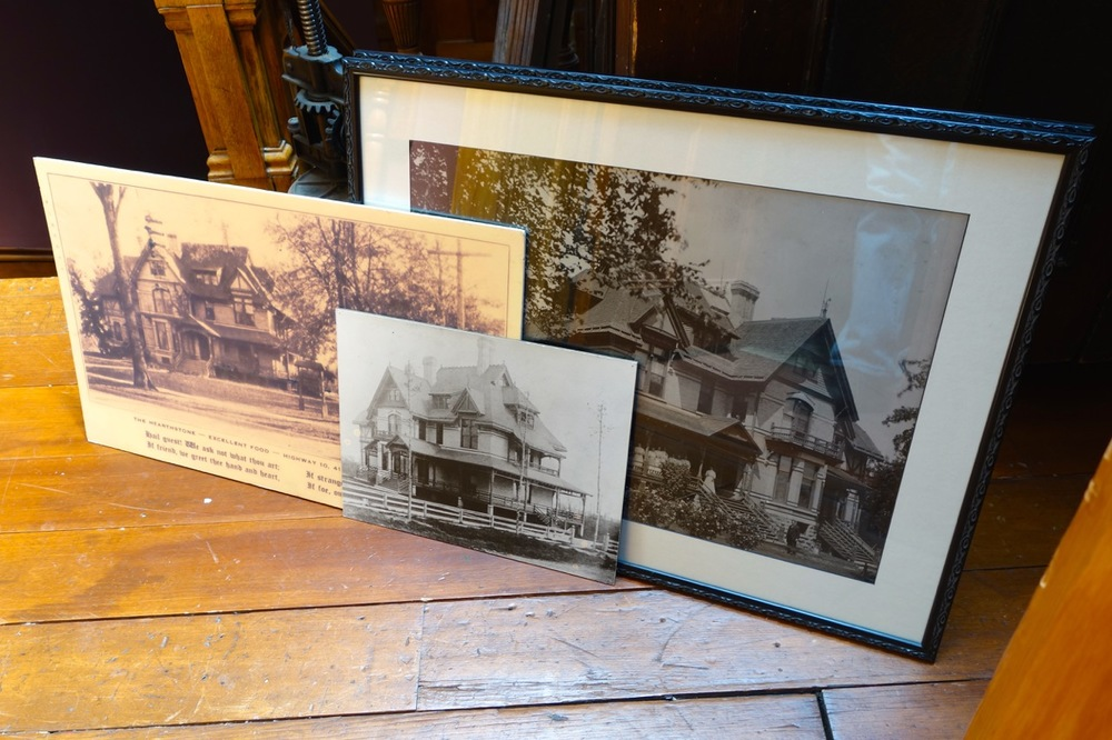 Photographs show what the garden looked like at different points in time. In front, the oldest photo shows the house surrounded by newly planted trees.  By the 1910's, these had matured and flowering shrubs were added. In the 1930's, the house became a restaurant.