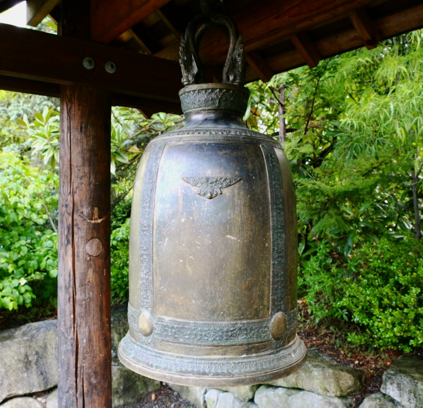 A hanging bell or bonsho marks the entrance to the garden.  Such bells are used in Buddhist temples as a call to prayer.