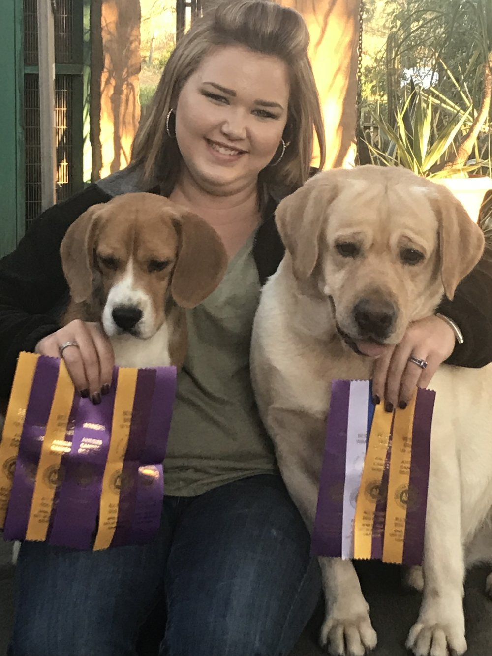 Lime (left), Warrick (right), and I after finishing their championships and winning the breed multiple times in the same weekend.