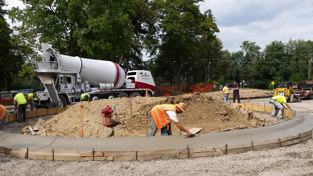 Concrete being poured on left and finished curbs on the right...handmade!