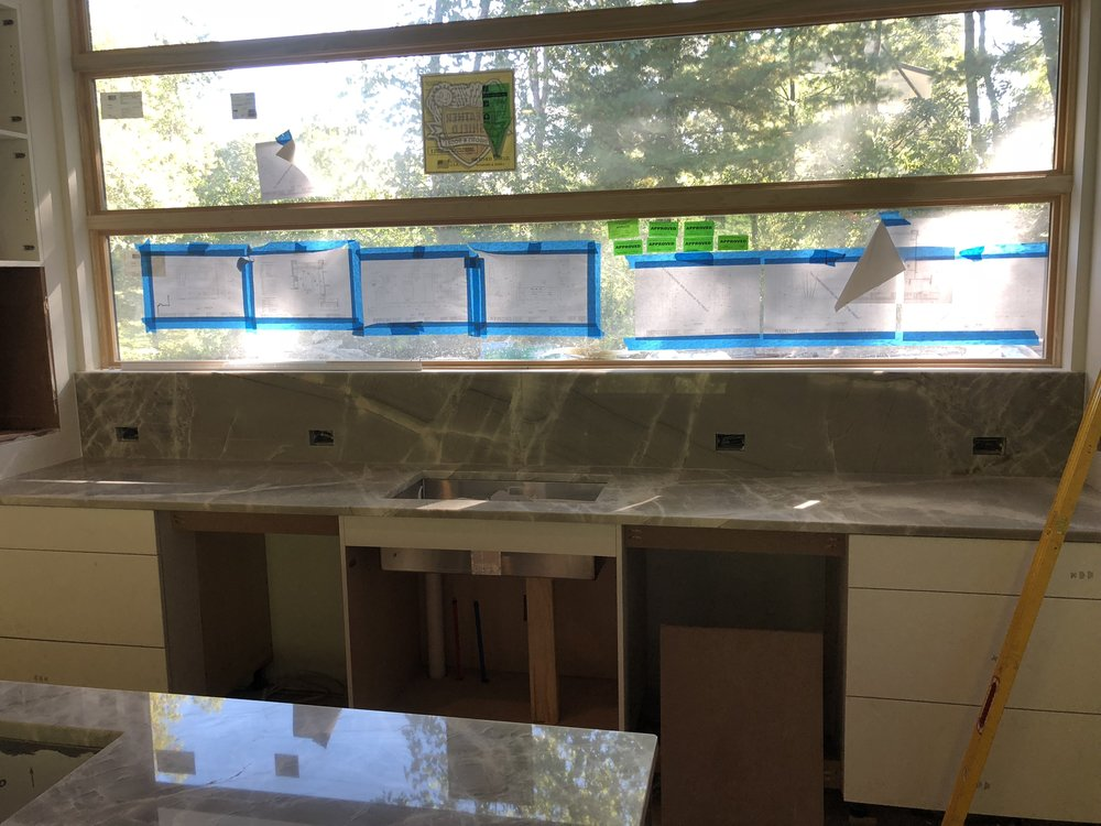 the sink countertops are in while the windows above let in tons of natural light