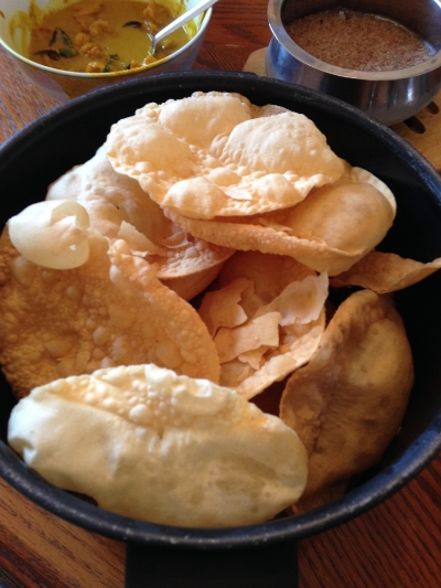 Papadums aka fried disks of crunchy deliciousness