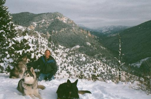 Brent with Kinau, Molson, and Nina at the top of Storm Castle Mountain.