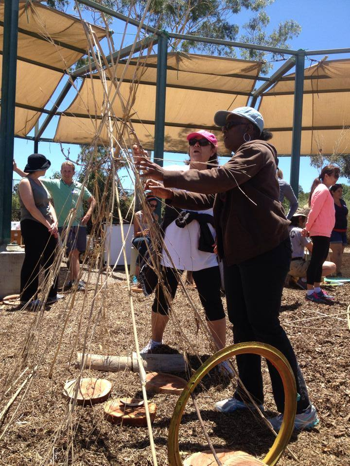 Teachers build with found materials at the outdoor learning space of EarthLab in Southeastern San Diego. After building they reflected on their experience to prepare for their students' participation in the activity the next week.