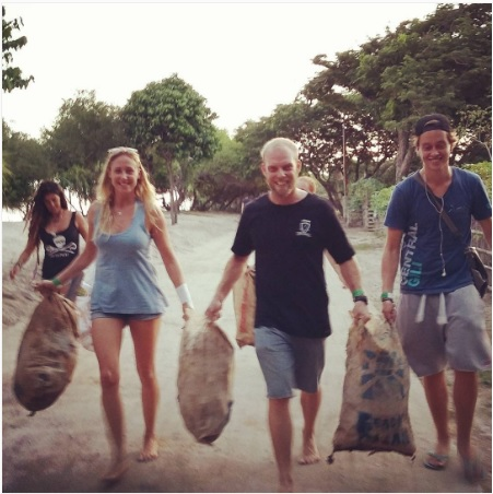 Team Work right here! With more hands we can carry more trash. Good job Kazi and Steve.