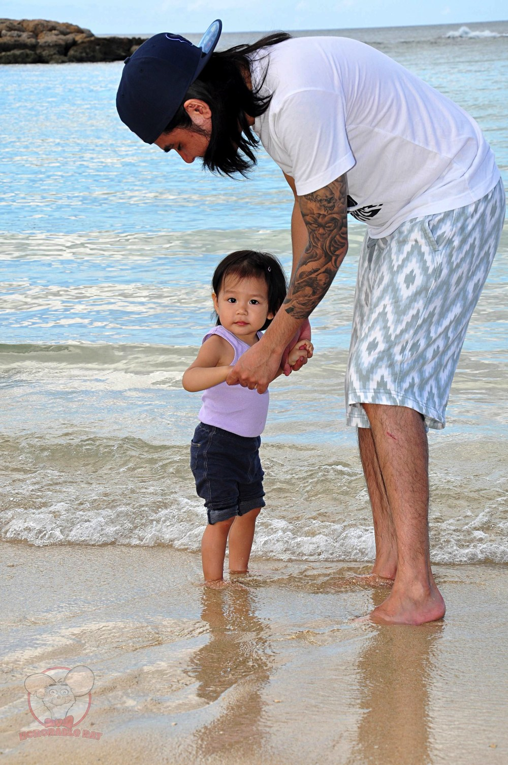 Mahina planting her feet into seawater for the first time