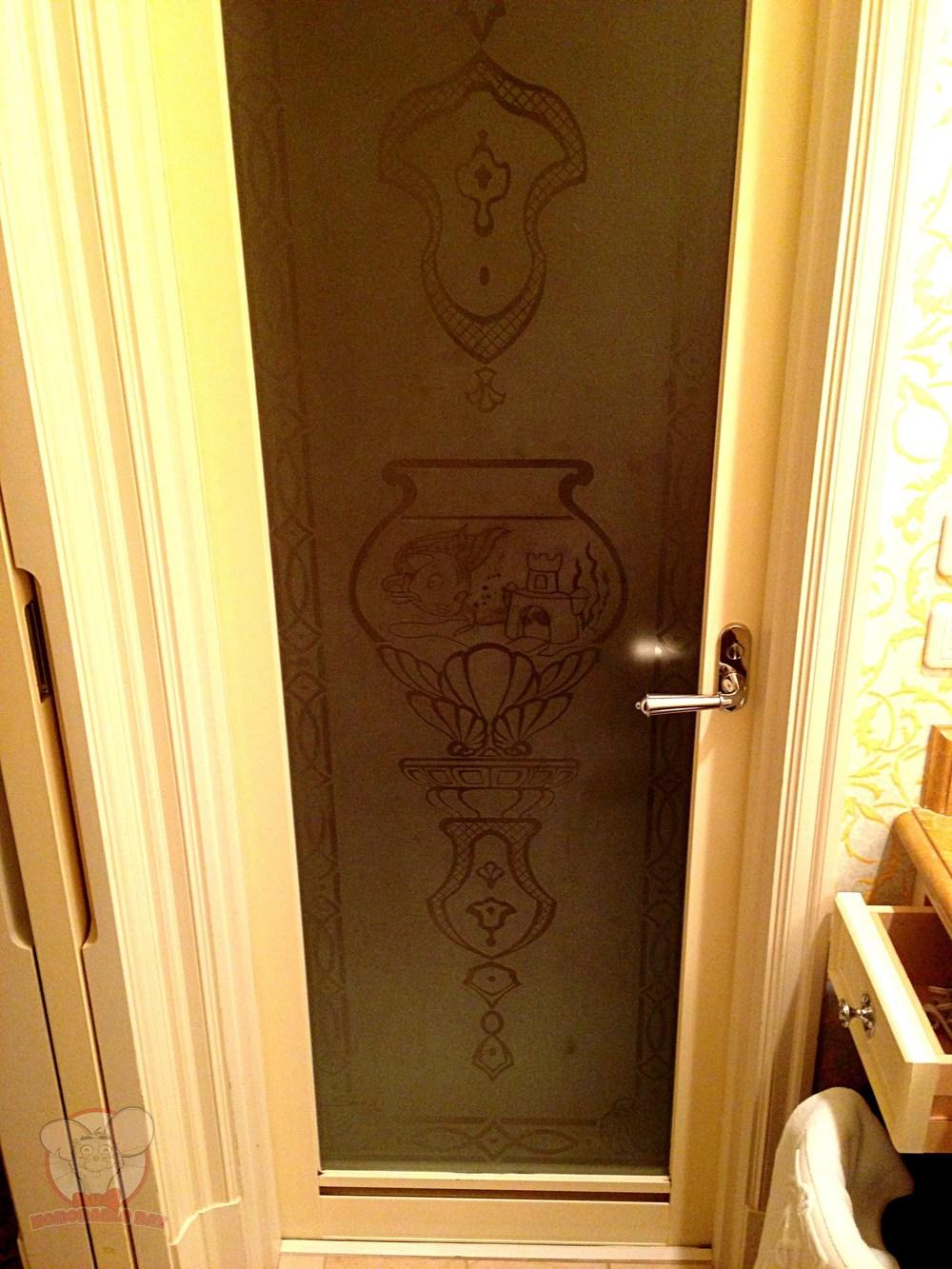Cleo on the toilet's door