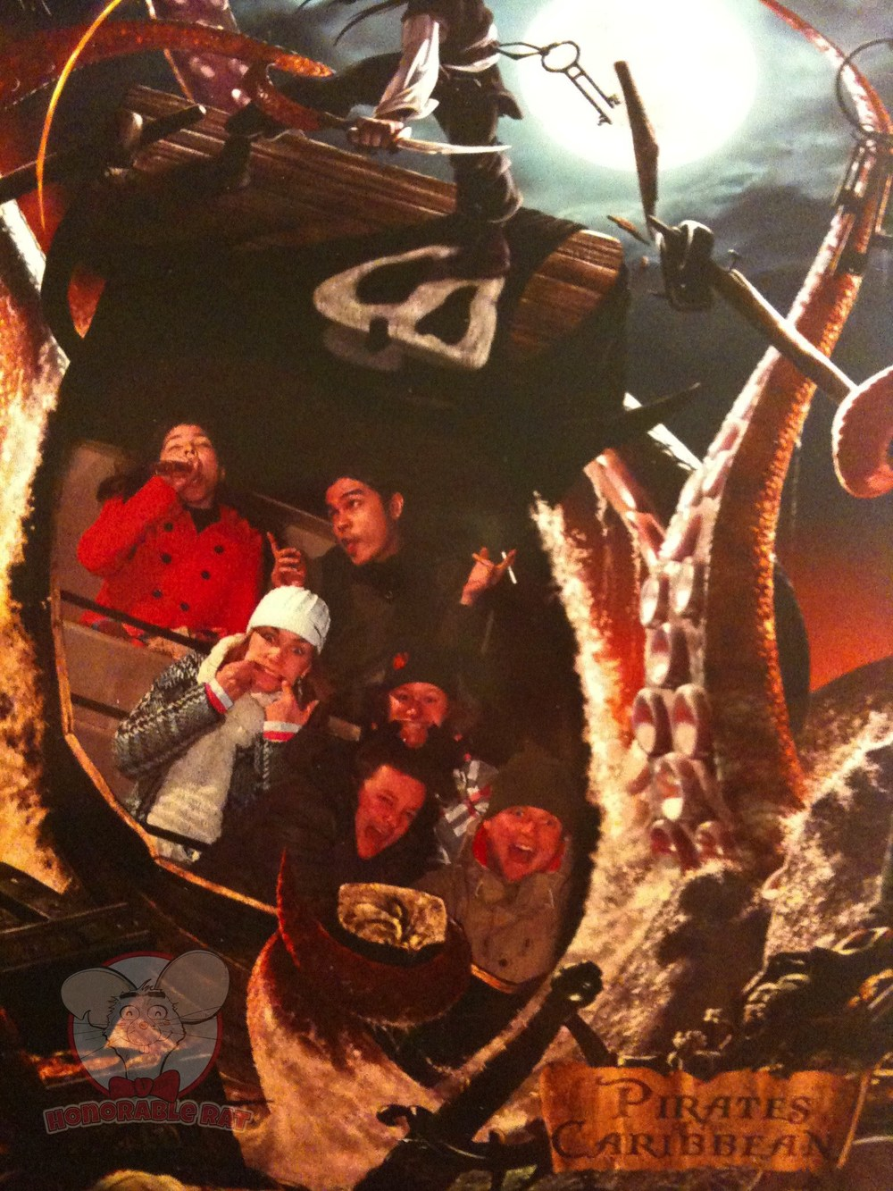 My sister, Nadia, and I posing in the last row for our ride photo on The Pirates of the Caribbean in Disneyland Paris . A lot of preparation went into this shot.