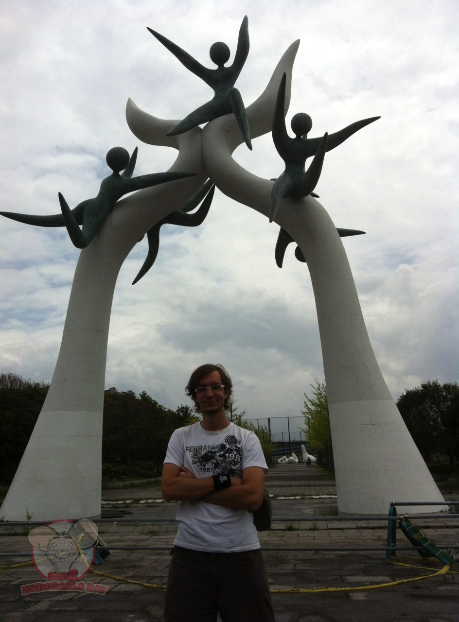 "Roman Tarassov aka K-9, lead guitarist for Moochie Mac & Superfriends, in front of the ""5 green men in the sky"" statue. Once you get to this statue, turn right and Disneysea will be just a stone's throw away."