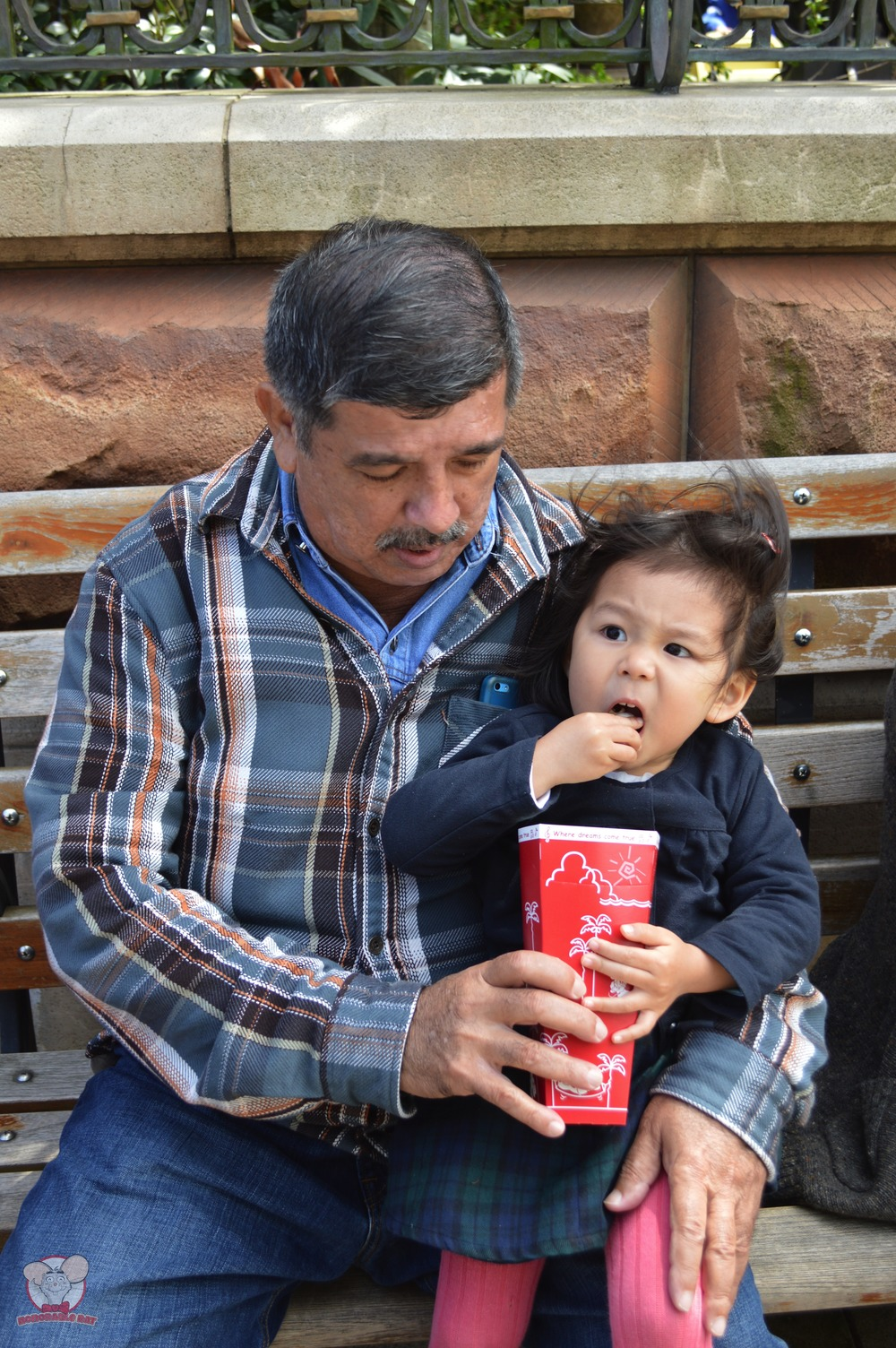 Little Mahina showing her Grandpa how much she loves popcorn