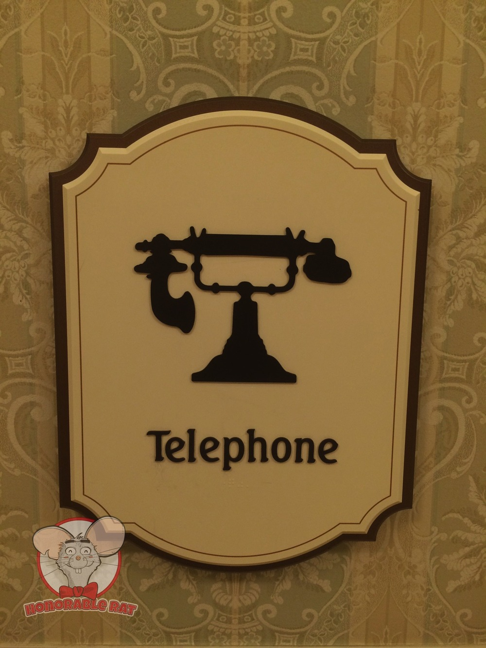 Look for this sign in Disney Hotels to find the source of power that will resurrect your dead phone
