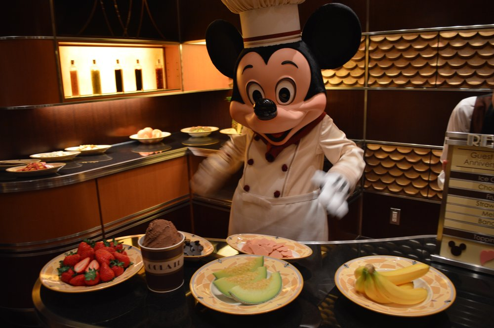 Mickey gets the ingredients ready for the kids' birthday parfait