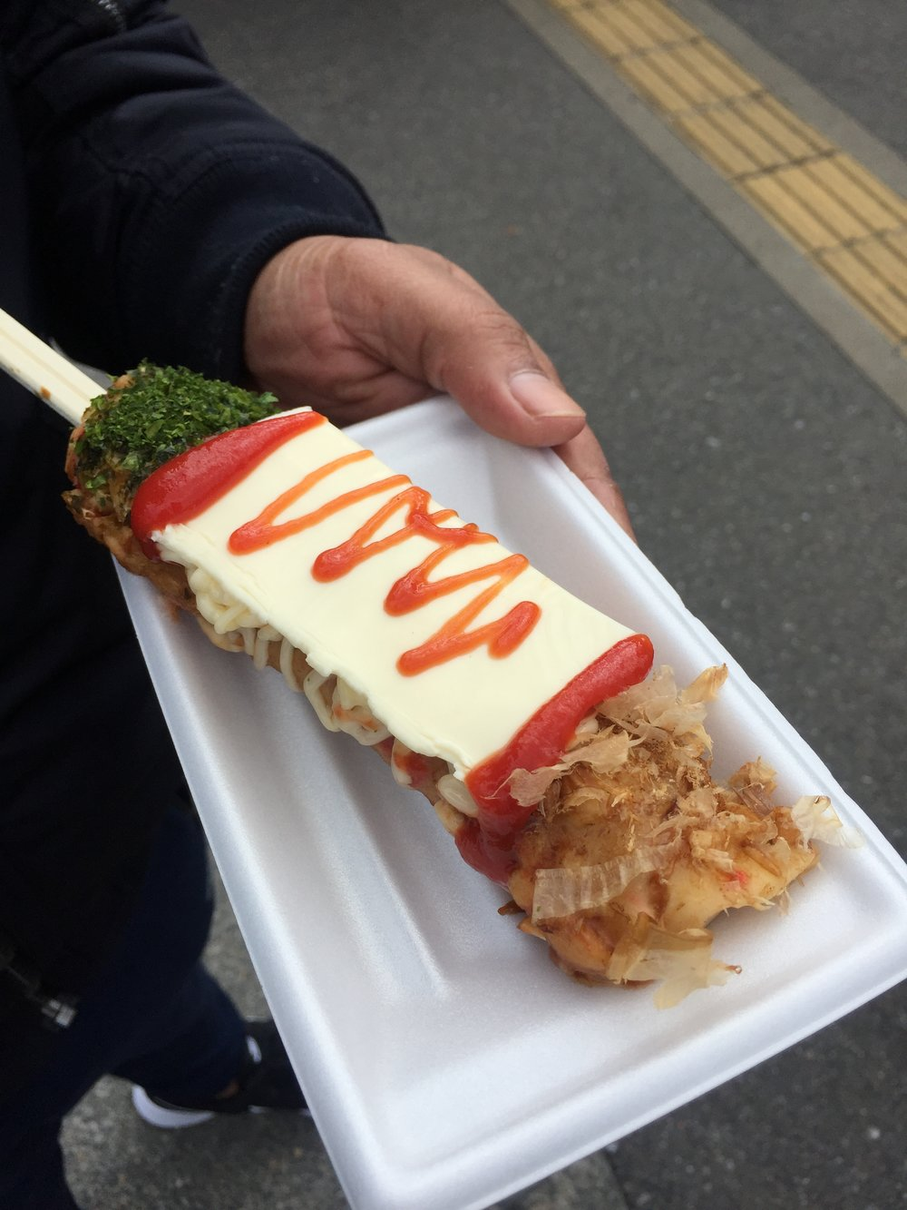 Why fumble with chopsticks when you can have your Okonomiyaki on a stick?
