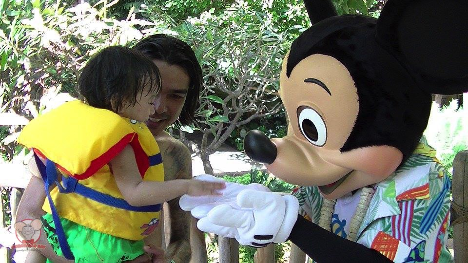 Baby Haku saying hello to Mickey Mouse