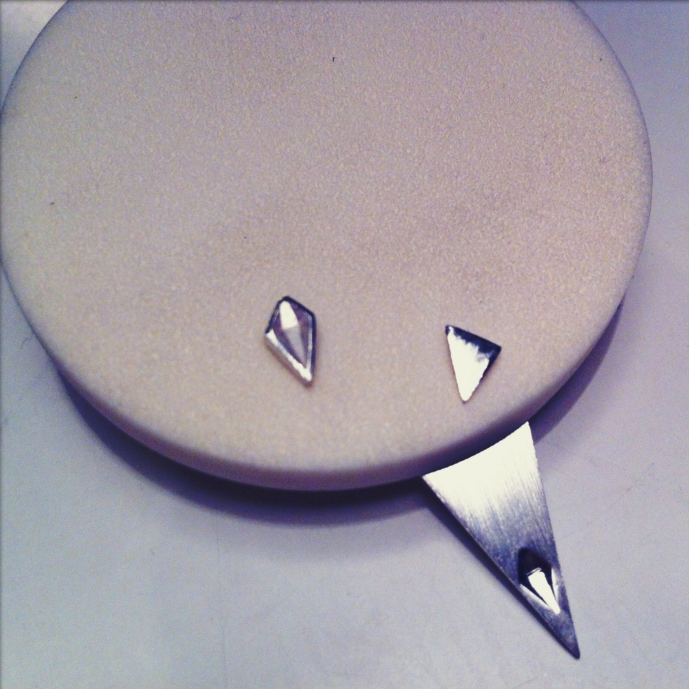 Pick earrings with diamond bevel