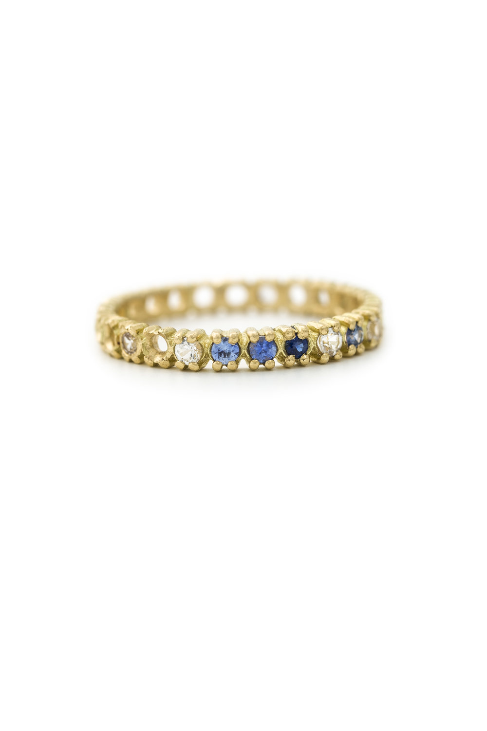 Multi coloured half eternity ring in yellow gold