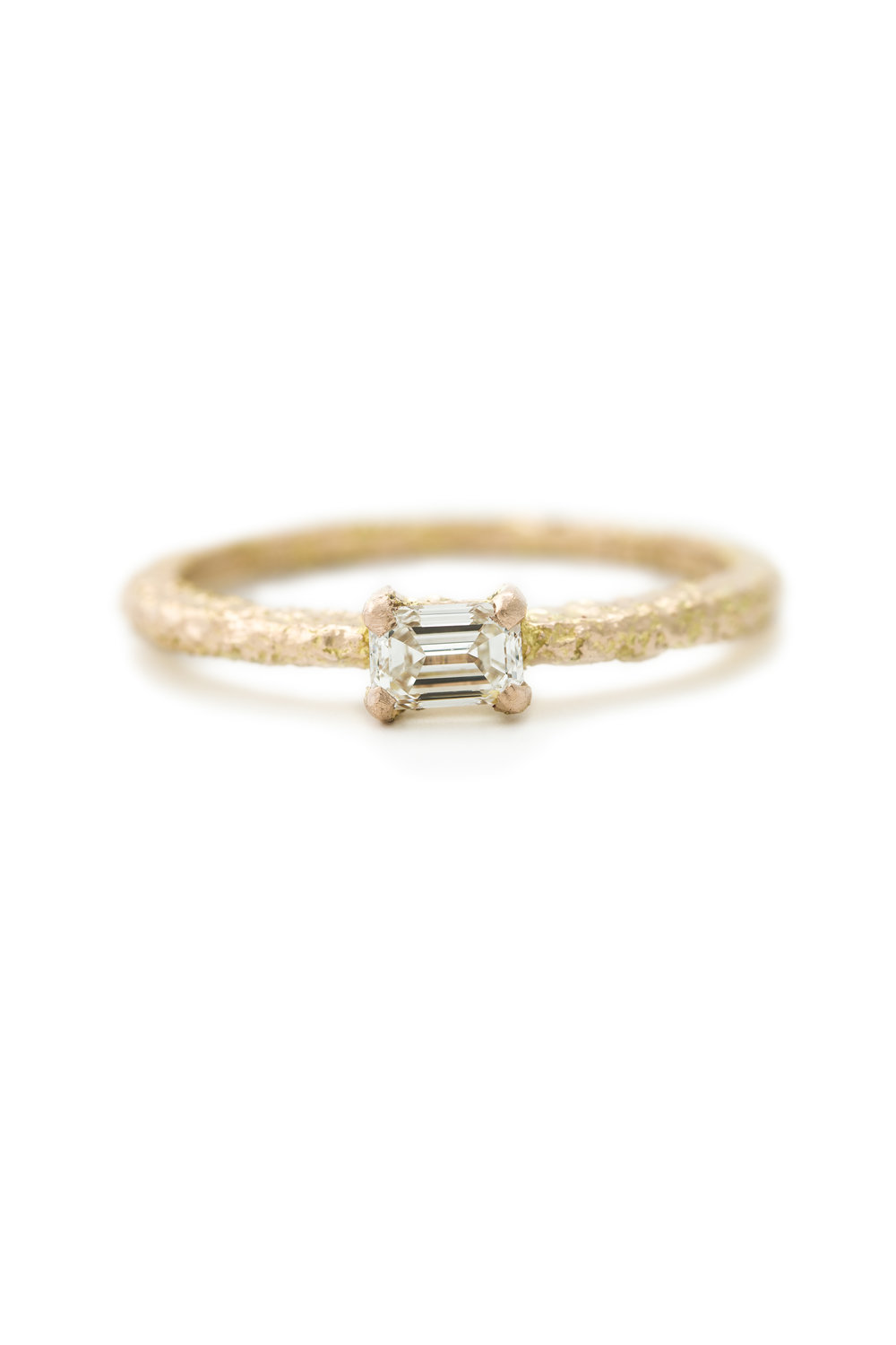 White emerald cut diamond ring in rose gold