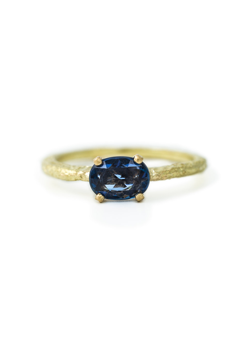 Oval rose cut sapphire ring in yellow gold
