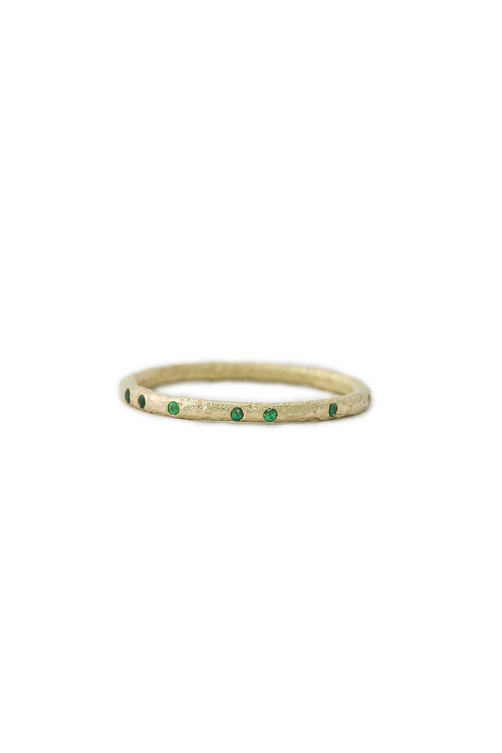 Yellow gold eternity ring with emeralds