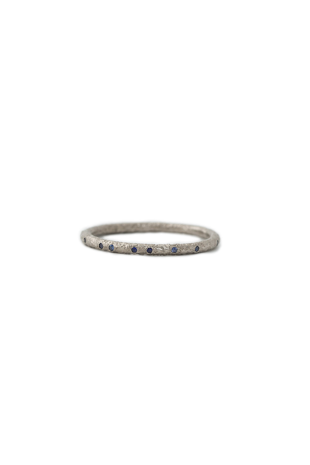 White gold eternity ring with sapphires