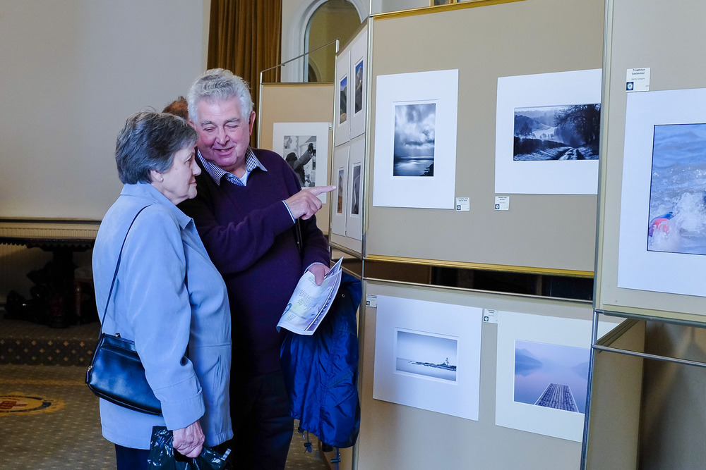 Visitors to the 2014 YPS Annual Exhibition of photographic prints. © Russell Watkins