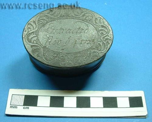 "A stone case containing a flat, ovoid urinary calculus, bearing the legend ""Extracted November the 4th, 1725.  Photo courtesy Royal College of Surgeons, from the (John) Hunterian Museum in Lincoln's Inn Fields, London.  Case 11, Bay 4; Object  RCSHM/Z 85."
