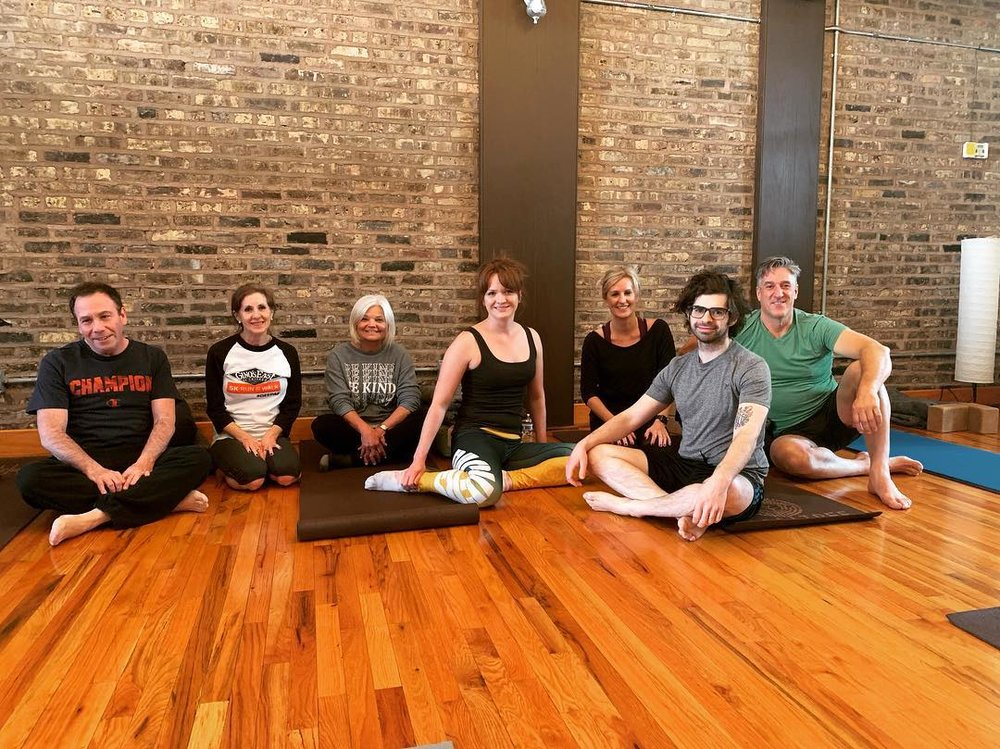 Great Lakes Clinical Trials research team taking a yoga break.