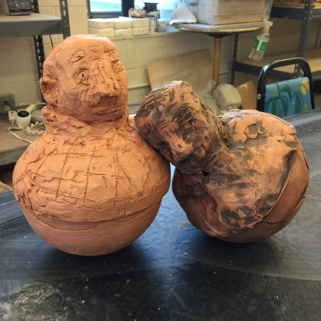 "Studio shot of 2 in-progress Pushover sculptures, red earthenware, 15""x10""x10"""