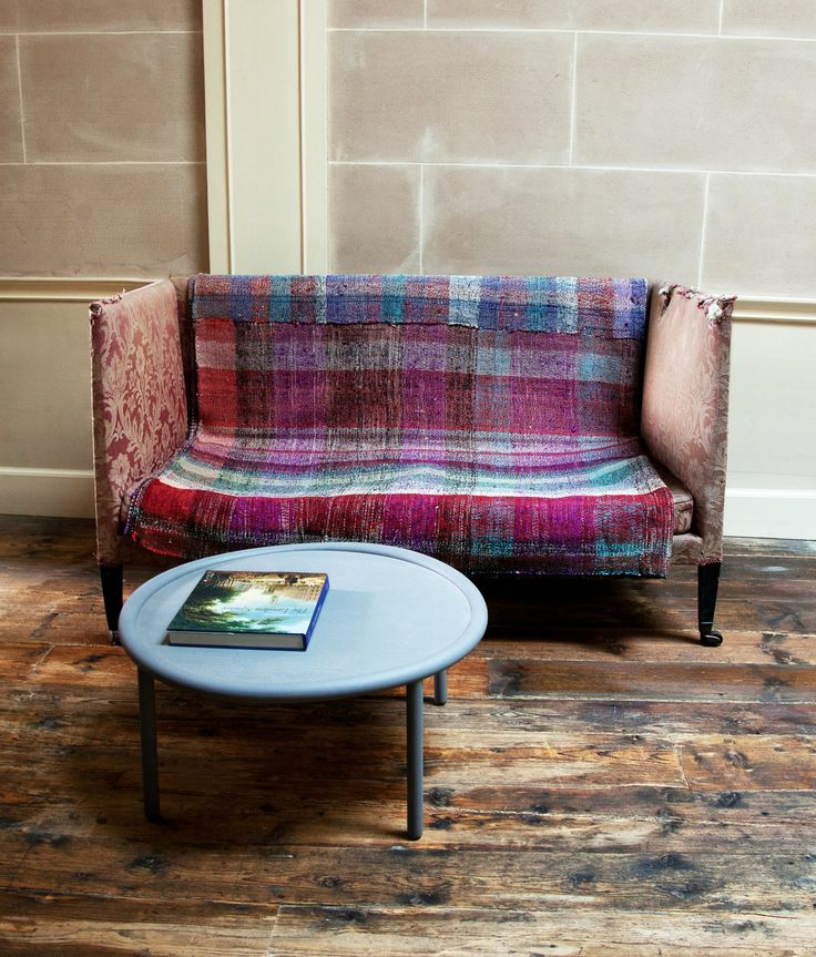Use rugs to add a textural layer to sofas, chairs, even tables - we also love hanging them on a wall
