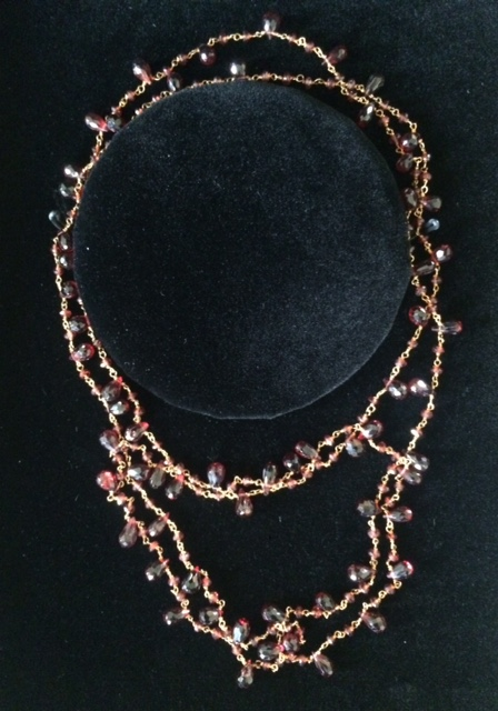 14K gold clad garnet necklace, value: $285