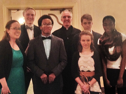 Mary Beth May, Thomas Viancort, Evan Turner, Fr. Larry, Camile Rehkemper, Stefan Rehkemper and Evana James,.
