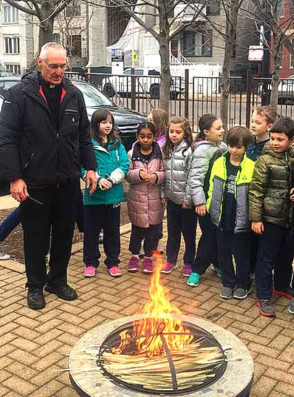 On Tuesday, the 2nd Graders joined me as we burned the palms from last year in preparation for the coming of Ash Wednesday.