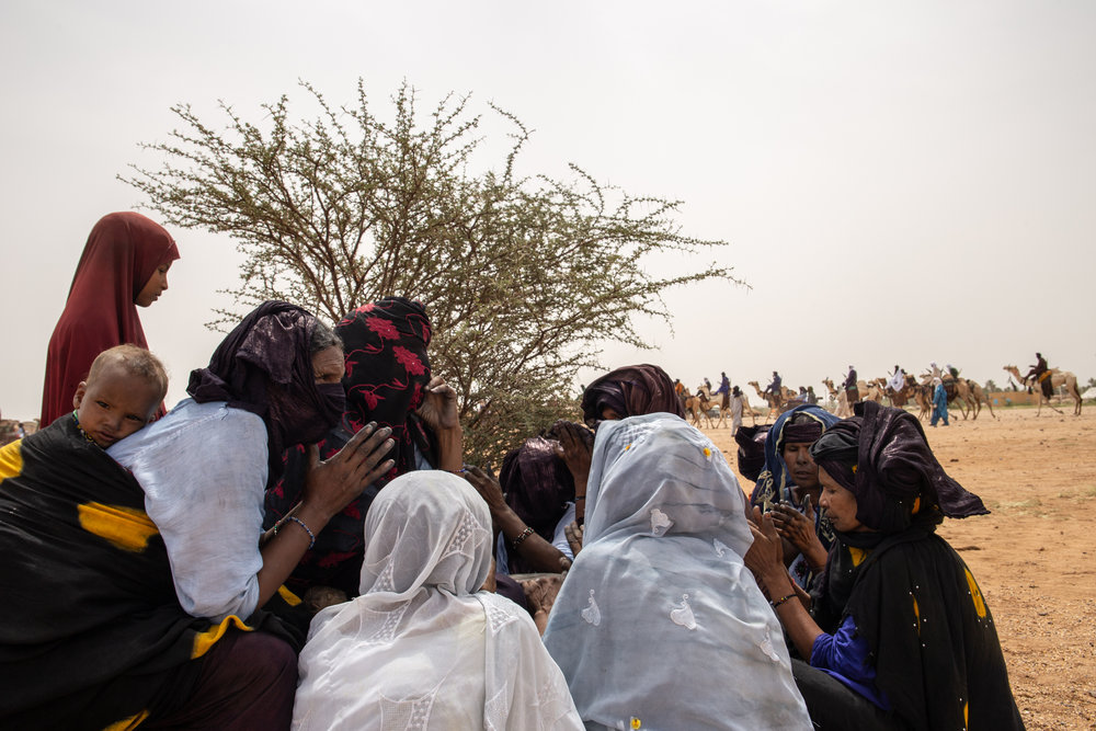 During the festival, day and night, Tuareg women sing in  tamashek  (Tuareg distinctive language) songs of freedom, love, travel or revolution to the rhythm of 'Tam Tam' (Tuareg drum), while their husbands lead camels in a circle around the music.