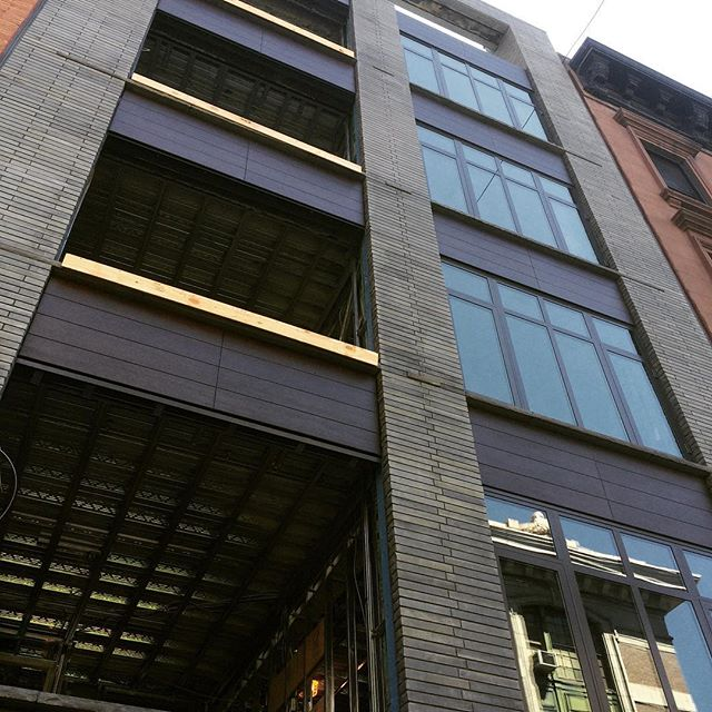 Our first look at the (nearly) complete facade! The windows will be installed after the drywall is loaded onto each floor through the openings. Congrats to the whole team for getting to this milestone!