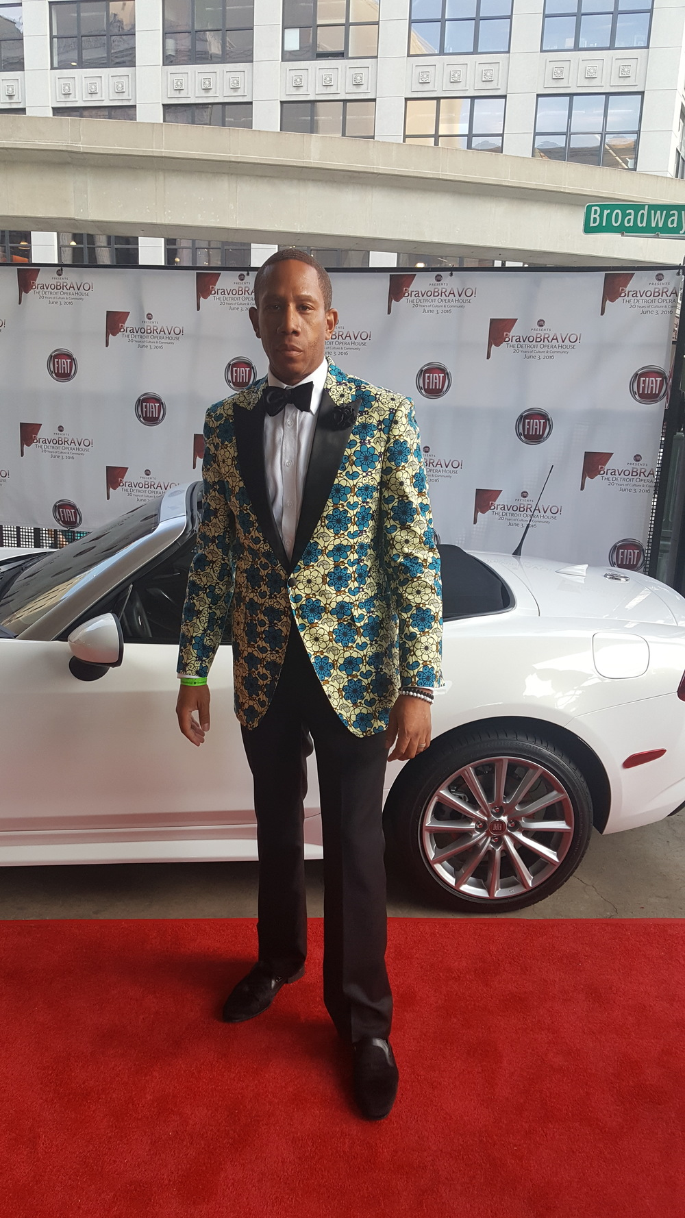 William Malcolm wearing a one of one African Wax Print Cotton Tuxedo jacket for Bravo!Bravo! Red Carpet. www.WilliamMalcolmCollection.com