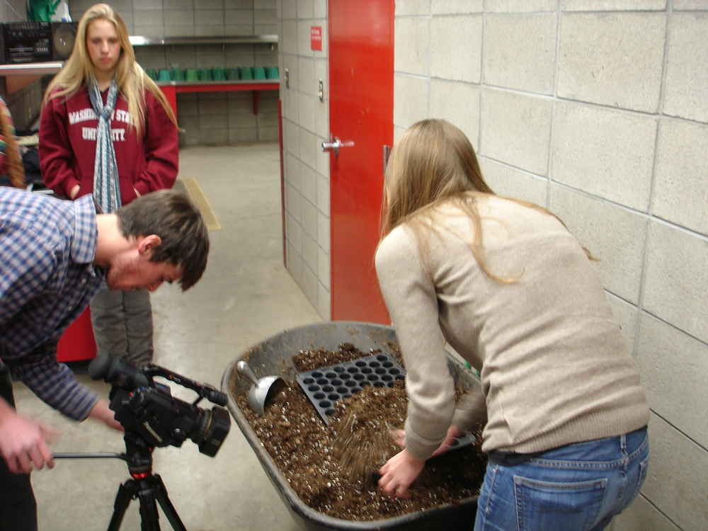 SamHedlund filming an early planting session with volunteers Amanda Anderson and Molly Titus-Ieronimo.