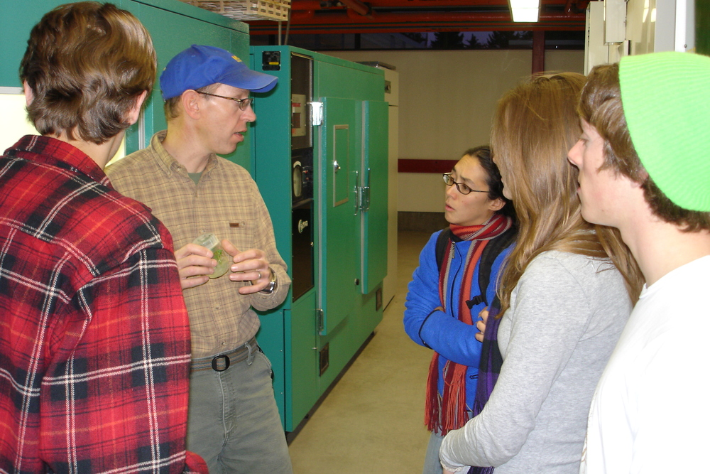 Montana State University Plant Growth Center Director David Baumbauer giving greenhouse tour to Dacotah Stordahl, Kareen Erbe, Kate Barber, and others.