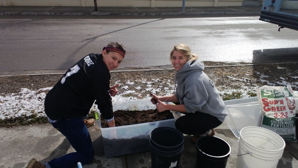 Interns Kate Moore and Rylea Rubright mixing up some soil.