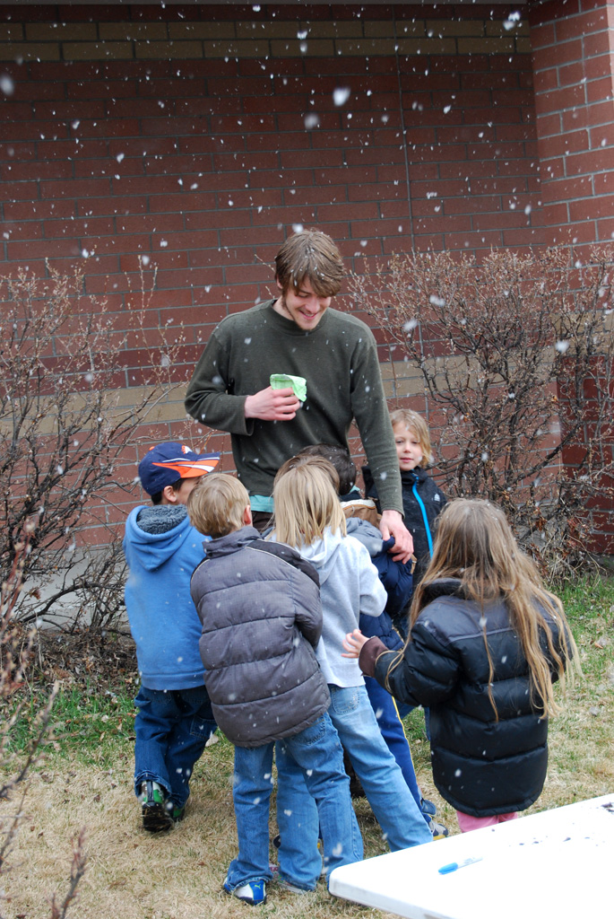 Snow day fun with AmeriCorps member Max Smith and Emily Dickinson kids.
