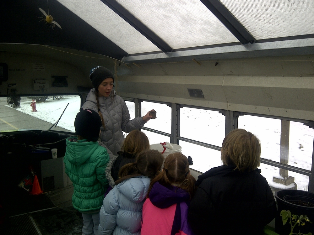 Gianna Andrews teaching. (You know you're in Montana when you have to bundle up for a greenhouse lesson.)