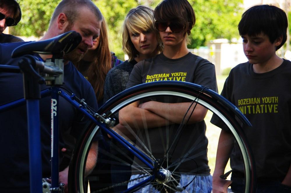 Casey from Bozeman Bike Kitchen teaches a workshop at Bozeman Youth Festival, 2009.
