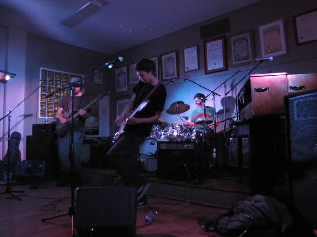 SIOUX FALLS at Gallatin Labor Temple. Isaac Eiger, near, guitar; Fred Nixon, bass; Patrick Murphy, drums.