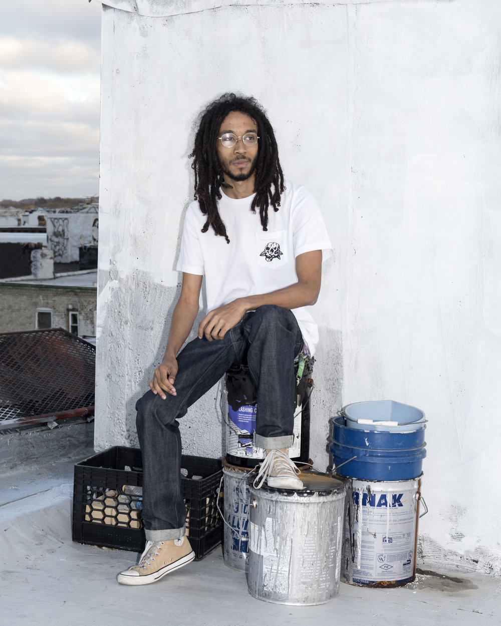 Jaydon sitting on paint buckets.jpg