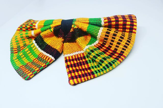 A custom kente bow tie with the vibrant colours for he eyes to see...